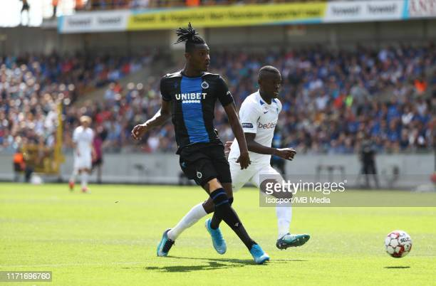 Simon Deli of Club Brugge battles for the ball with Ally Samatta of Krc Genk during the Jupiler Pro League match between Club Brugge KV and KRC Genk...