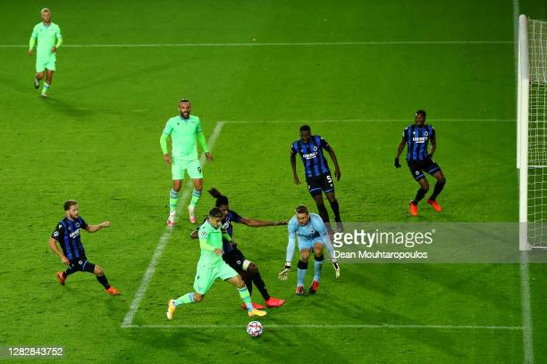 Simon Deli of Club Brugge KV battles for the ball with Andreas Pereira of SS Lazio during the UEFA Champions League Group F stage match between Club...