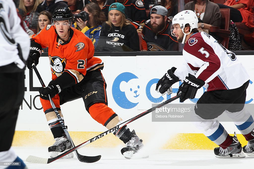 Simon Despres #24 of the Anaheim Ducks skates against Nate Guenin #5 of the Colorado Avalanche on October 16, 2015 at Honda Center in Anaheim, California.