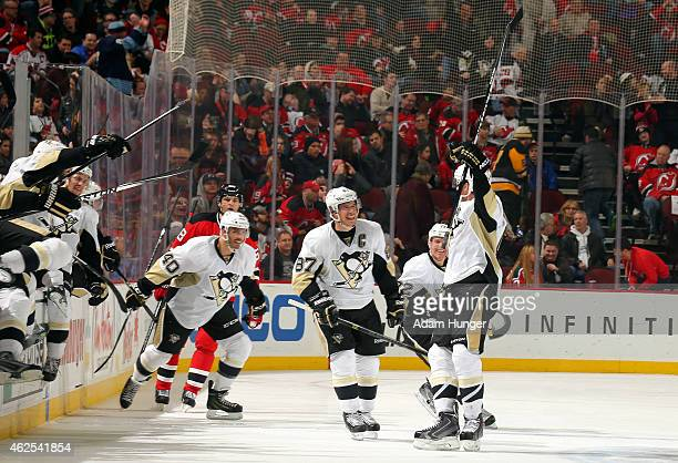 Simon Despres of the Pittsburgh Penguins celebrates with Sidney Crosby of the Pittsburgh Penguins and teammates after scoring the game winning goal...