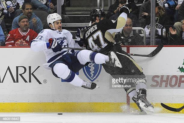 Simon Despres of the Pittsburgh Penguins hits Brian Boyle of the Tampa Bay Lightning in the second period at Consol Energy Center on December 15 2014...