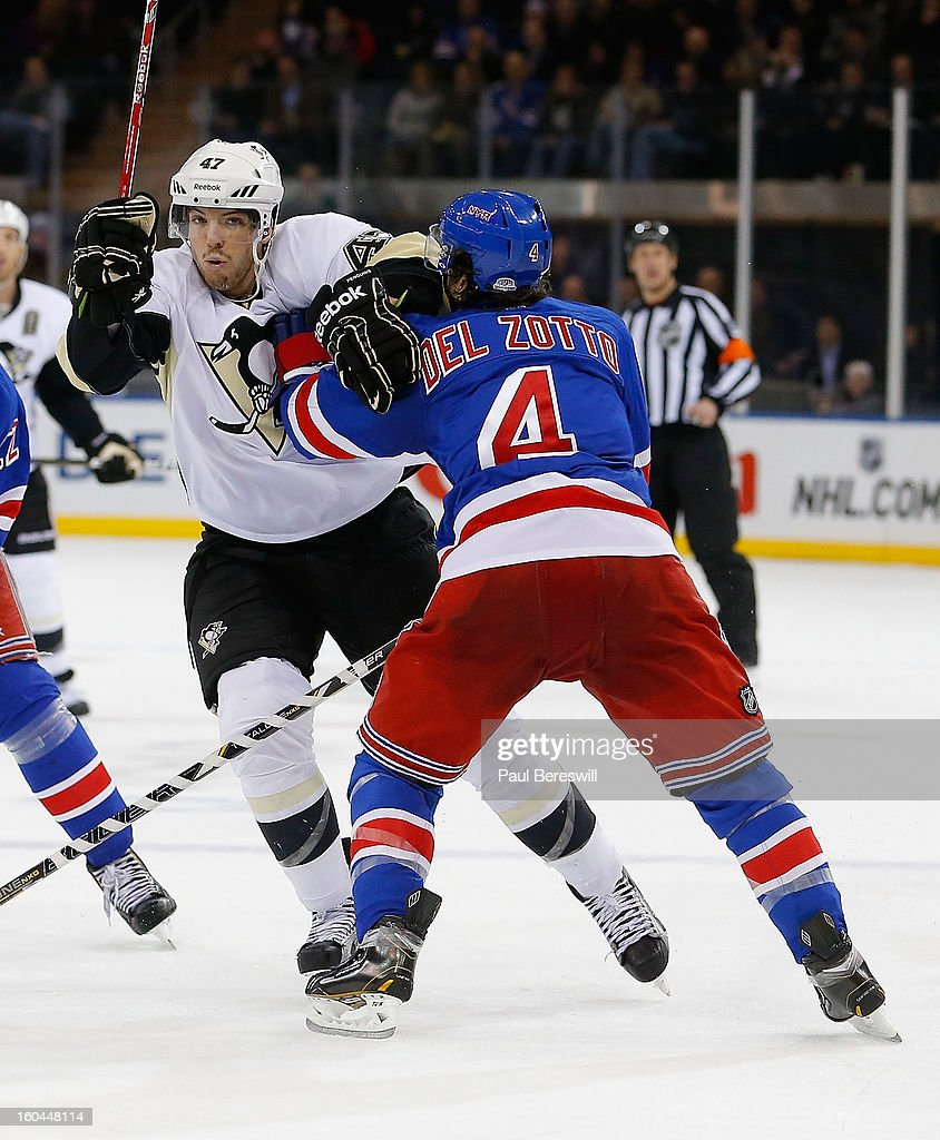 Simon Despres #47 of the Pittsburgh Penguins is checked by Michael Del Zotto #4 of the New York Rangers trying to skate into the Rangers' zone in the third period of an NHL hockey game at Madison Square Garden on January 31, 2013 in New York City.