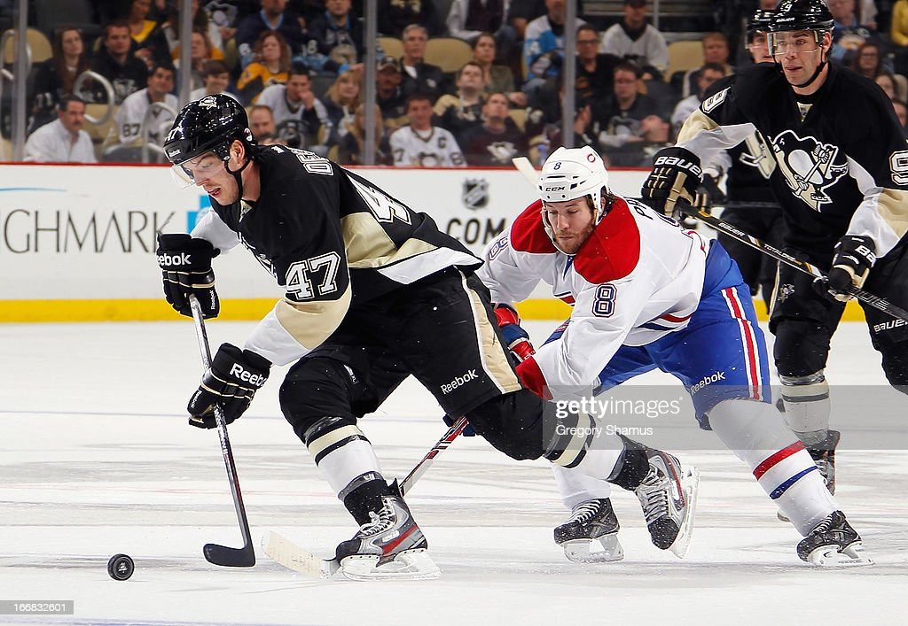Simon Despres #47 of the Pittsburgh Penguins moves the puck up ice in front of Brandon Prust #8 of the Montreal Canadiens on April17, 2013 at Consol Energy Center in Pittsburgh, Pennsylvania.
