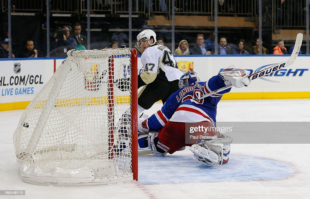 Simon Despres #47 of the Pittsburgh Penguins shoots the puck past goalie Henrik Lundqvist #30 of the New York Rangers for a goal in the third period of an NHL hockey game at Madison Square Garden on January 31, 2013 in New York City.