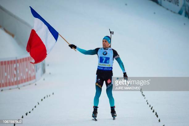 Simon Desthieux of France celebrates on the finish straight as he wins Single Mixed Relay competition of the IBU Biathlon World Cup in Pokljuka on...