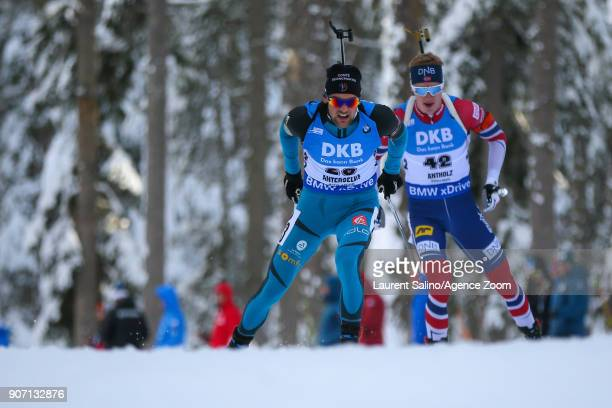 Simon Desthieux of France competes Johannes Thingnes Boe of Norway takes 1st place during the IBU Biathlon World Cup Men's Sprint on January 19 2018...