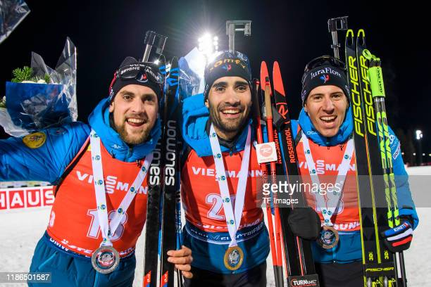 Simon Desthieux of France, Martin Fourcade of France and Quentin Fillon Maillet of France after the medal ceremony during the Men 20 km Individual...