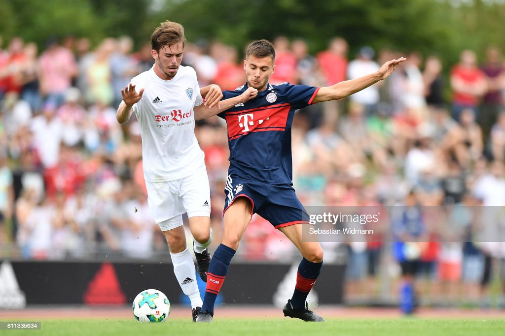 Simon Driesslein of FSV Erlangen-Bruck and Milos Pantovic of FC Bayern Muenchen compete for the ball during the preseason friendly match between FSV Erlangen-Bruck and Bayern Muenchen at Adi Dassler Sportplatz on July 9, 2017 in Herzogenaurach, Germany.