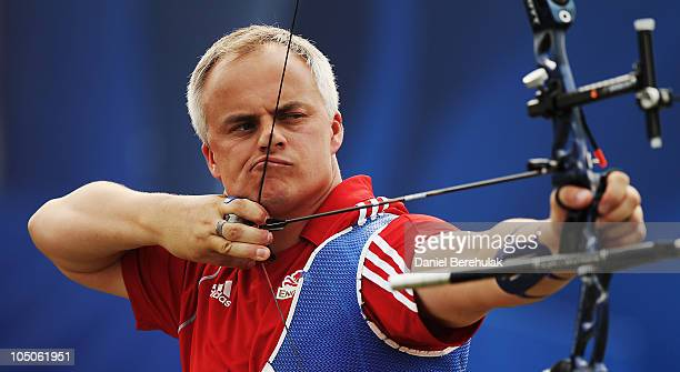 Simon Duncan Terry of England competes in the Men's Team Recurve event at Yamuna Sports Complex during day five of the Delhi 2010 Commonwealth Games...