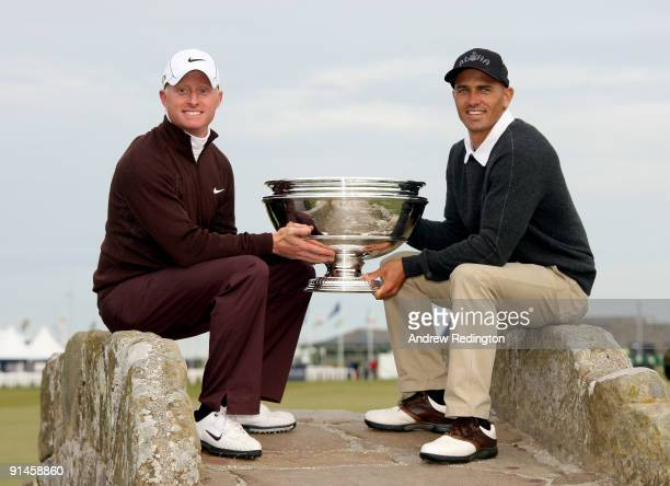 Simon Dyson of England and his playing partner Kelly Sltaer hold the trophy aloft after victory at the The Alfred Dunhill Links Championship at The...