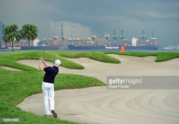 Simon Dyson of England plays a bunker shot during the second round of the Barclays Singapore Open at the Sentosa Golf Club on November 9 2012 in...