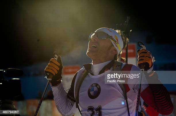Simon Eder at the finish line celebrating his third place on Biathlon World Cup 15km Mass Start Men on Pokljuka 2014.