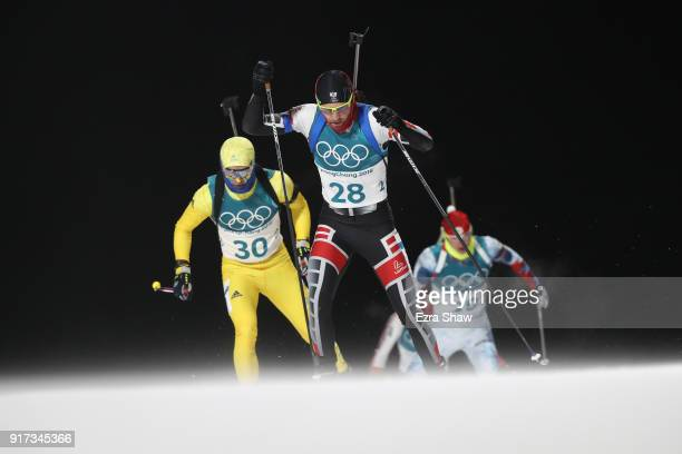 Simon Eder of Austria and Jesper Nelin of Sweden compete during the Men's Biathlon 125km Pursuit on day three of the PyeongChang 2018 Winter Olympic...
