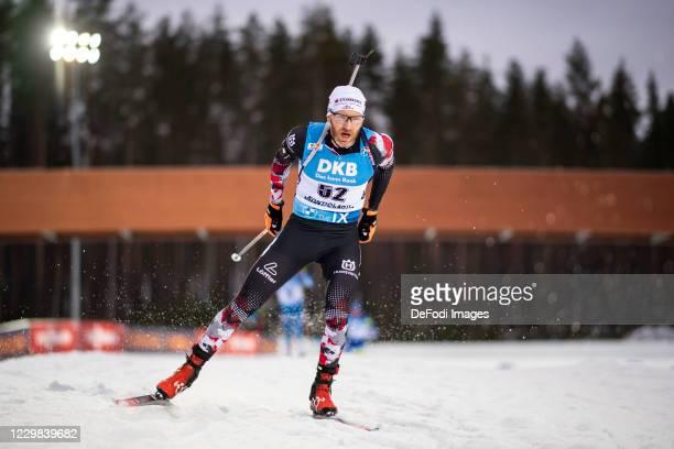 Simon Eder of Austria at the shooting range during the Men 20 km Individual Competition at the BMW IBU World Cup Biathlon Season Opening Kontiolahti...