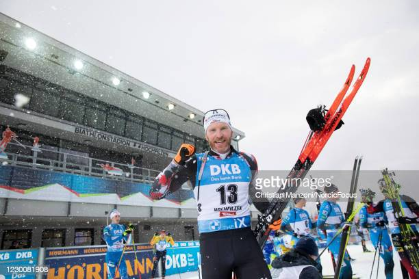 Simon Eder of Austria celebrates during the Men 12.5 km Pursuit Competition at the BMW IBU World Cup Biathlon Hochfilzen at on December 12, 2020 in...