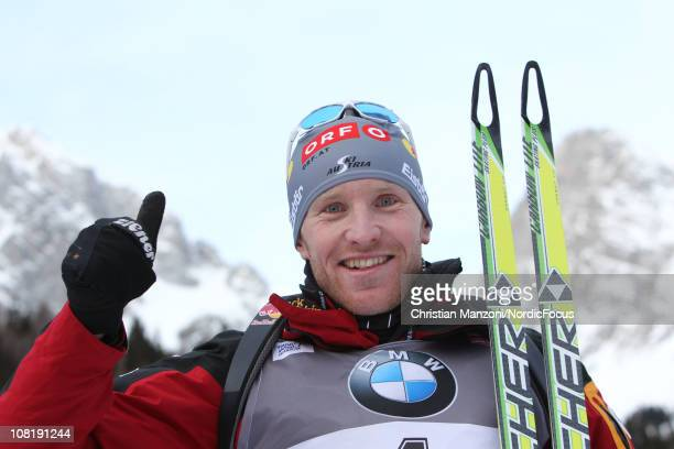 Simon Eder of Austria celebrates his fourth place in the men's sprint during the EON IBU Biathlon World Cup on January 20 2011 in AntholzAnterselva...