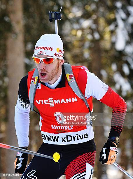 Simon Eder of Austria competes during the Men's 125 km Pursuit race of the IBU Biathlon World Cup on January 24 2015 in the Italian Alpine resort of...