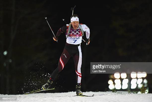 Simon Eder of Austria competes in the Men's 12.5 km Pursuit during day three of the Sochi 2014 Winter Olympics at Laura Cross-country Ski & Biathlon...