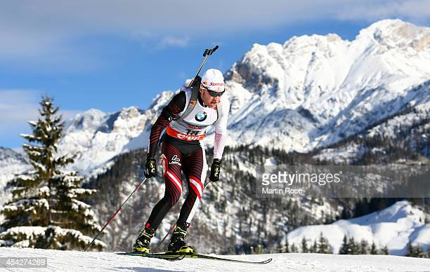 Simon Eder of Austria competes in the men's 125km pursuit event during the IBU Biathlon World Cup on December 8 2013 in Hochfilzen Austria