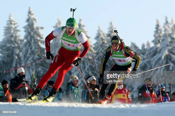 Simon Eder of Austria competes infront of Christoph Stephan of Germany during the Men's 4 x 7,5km Relay in the e.on Ruhrgas IBU Biathlon World Cup on...