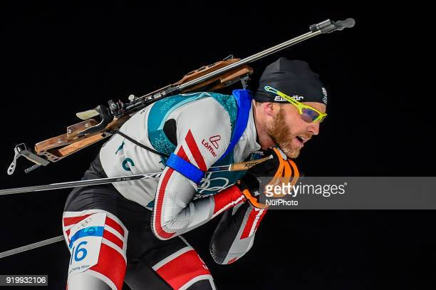 Simon Eder of Austria competing in 15 km mass start biathlon at Alpensia Biathlon Centre Pyeongchang South Korea on February 18 2018
