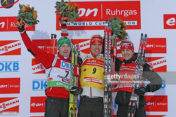 Simon Eder of Austria Emil Hegle Svendsen of Norway and Ole Einar Bjoerndalen of Norway during the Flower Ceremony after the men's 125km pursuit on...