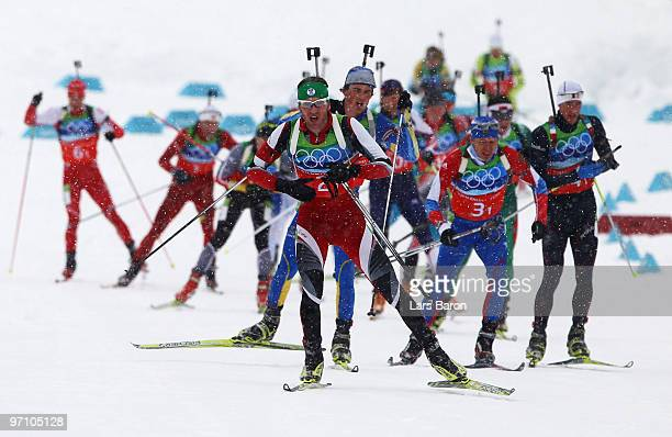 Simon Eder of Austria leads the pack during the men's 4 x 75 km biathlon relay on day 15 of the 2010 Vancouver Winter Olympics at Whistler Olympic...