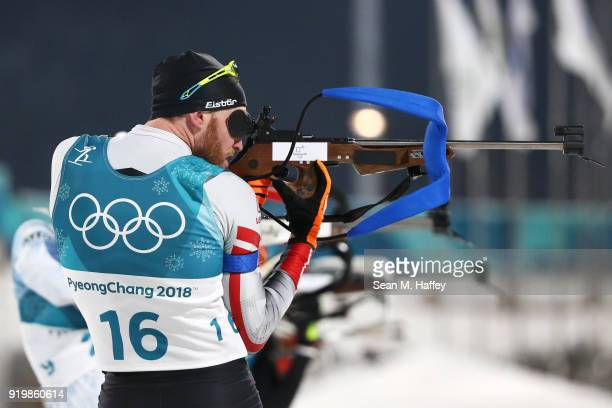 Simon Eder of Austria shoots during the Men's 15km Mass Start Biathlon on day nine of the PyeongChang 2018 Winter Olympic Games at Alpensia Biathlon...