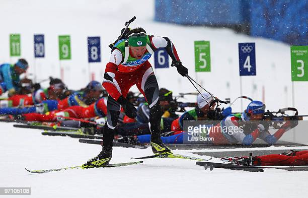 Simon Eder of Austria skis past the shooting range during the men's 4 x 75 km biathlon relay on day 15 of the 2010 Vancouver Winter Olympics at...