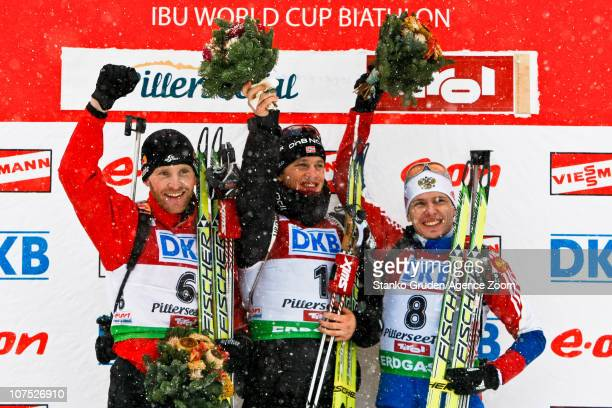 Simon Eder of Austria takes 2nd place Tarjei Boe of Norway takes 1st place Ivan Tcherezov of Russia takes 3rd place during the IBU World Cup Biathlon...