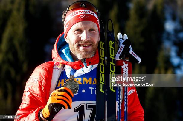 Simon Eder of Austria wins the bronze medal during the IBU Biathlon World Championships Men's and Women's Mass Start on February 19 2017 in...