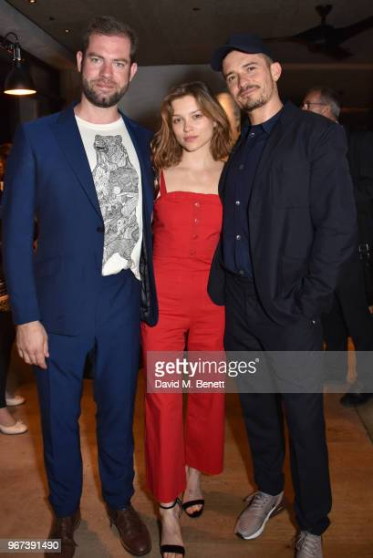 Simon Evans Sophie Cookson and Orlando Bloom attend the press night after party for Killer Joe at Leicester Square Kitchen on June 4 2018 in London...