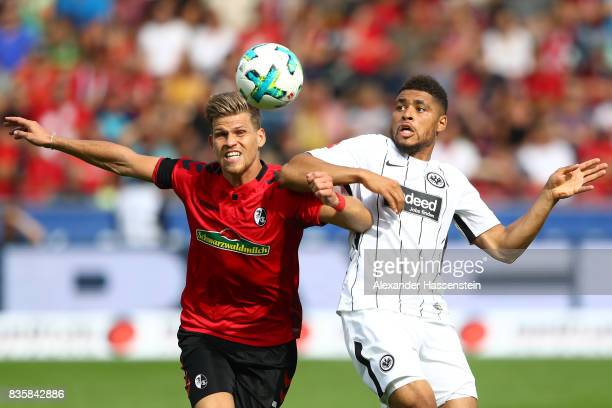 Simon Falette of Frankfurt and Florian Niederlechner of FC Freiburg during the Bundesliga match between SportClub Freiburg and Eintracht Frankfurt at...
