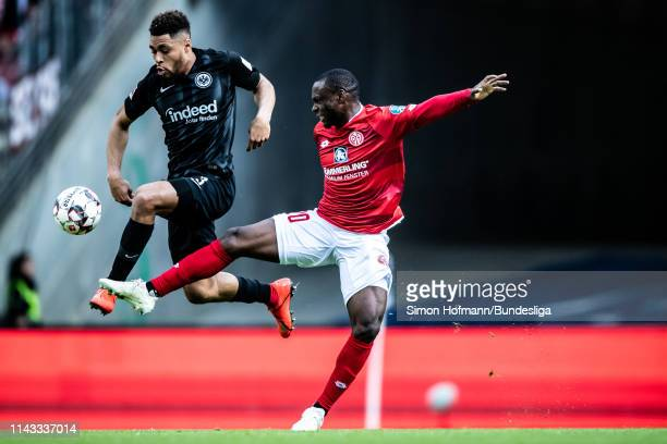 Simon Falette of Frankfurt is tackled by Anthony Ujah of Mainz during the Bundesliga match between Eintracht Frankfurt and 1 FSV Mainz 05 at...