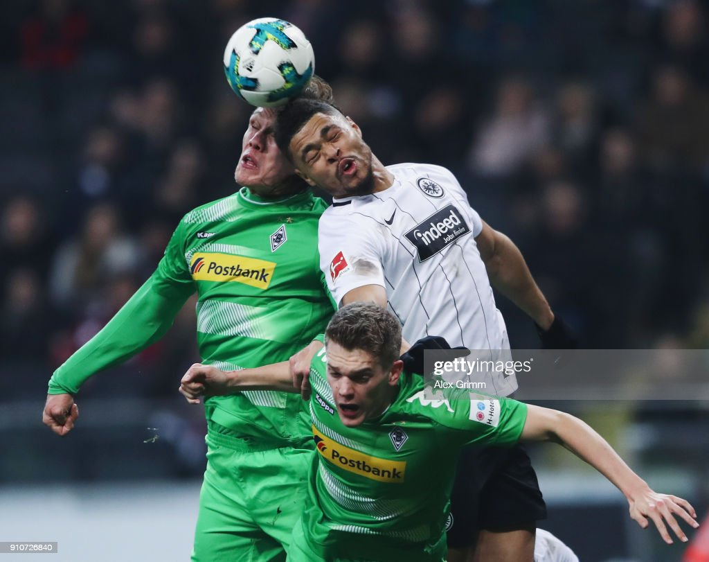 Simon Falette of Frankfurt jumps for a header with Jannik Vestergaard and Matthias Ginter (front) of Moenchengladbach during the Bundesliga match between Eintracht Frankfurt and Borussia Moenchengladbach at Commerzbank-Arena on January 26, 2018 in Frankfurt am Main, Germany.