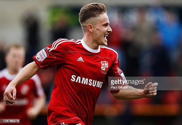 Simon Ferry of Swindon Town celebrates scoring the third goal for Swindon Town during the npower League Two match between Swindon Town and Hereford...