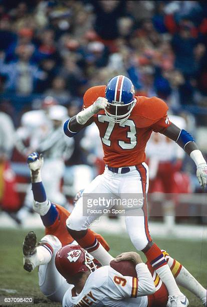 Simon Fletcher of the Denver Broncos sacks Bill Kenney of the Kansas City Chiefs during an NFL football game December 19 1987 at Mile High Stadium in...