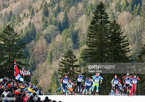 Simon Fourcade of France leads the pack off the start during the IBU Biathlon World Cup Men's Relay on January 15, 2015 in Ruhpolding, Germany.