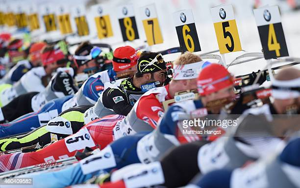 Simon Fourcade of France shoots at the range as he competes during the Men's 4 x 75 km relay event in the IBU Biathlon World Cup on December 13 2014...