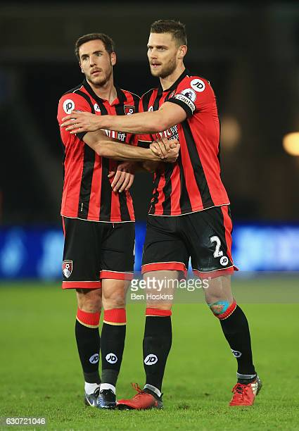 Simon Francis and Dan Gosling of AFC Bournemouth celebrate their win after the Premier League match between Swansea City and AFC Bournemouth at...