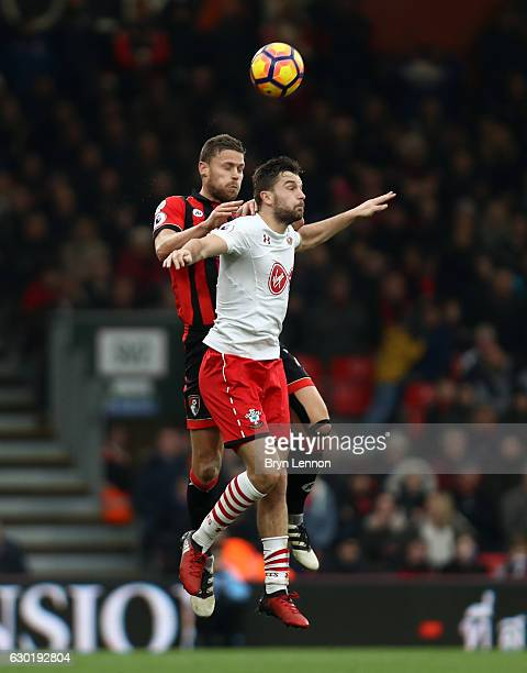 Simon Francis of AFC Bournemouth and Jay Rodriguez of Southampton battle to win a header during the Premier League match between AFC Bournemouth and...