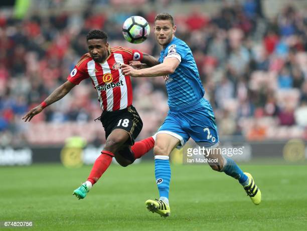 Simon Francis of AFC Bournemouth and Jermain Defoe of Sunderland clash during the Premier League match between Sunderland and AFC Bournemouth at the...