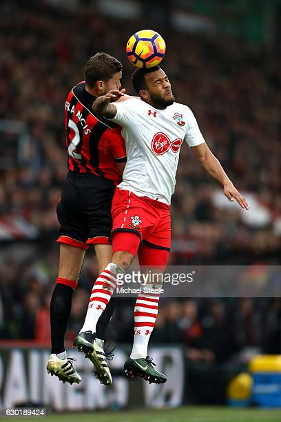Simon Francis of AFC Bournemouth and Ryan Bertrand of Southampton battle to win a header during the Premier League match between AFC Bournemouth and...