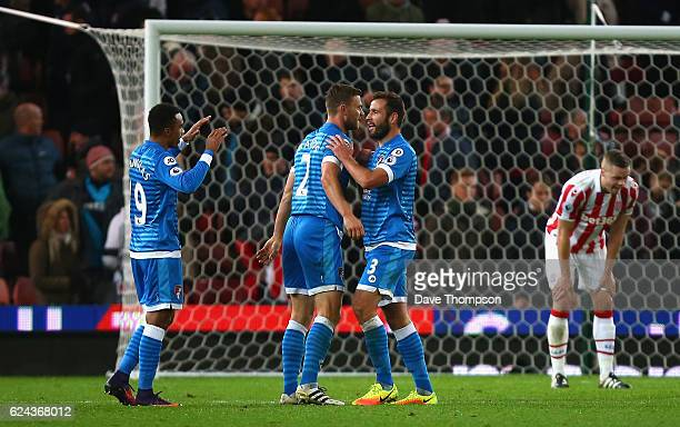 Simon Francis of AFC Bournemouth and Steve Cook of AFC Bournemouth celebrate after the final whistle during the Premier League match between Stoke...
