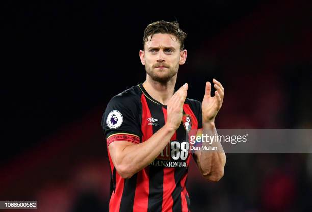 Simon Francis of AFC Bournemouth applauds fans after the Premier League match between AFC Bournemouth and Huddersfield Town at Vitality Stadium on...