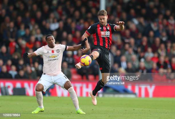 Simon Francis of AFC Bournemouth beats Anthony Martial of Manchester United to the ball during the Premier League match between AFC Bournemouth and...