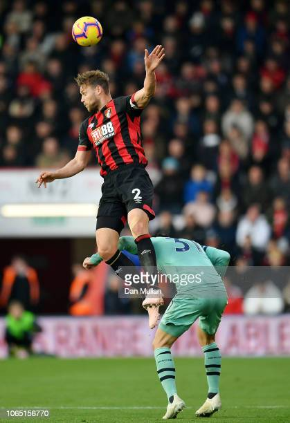 Simon Francis of AFC Bournemouth headers the ball over Sead Kolasinac of Arsenal during the Premier League match between AFC Bournemouth and Arsenal...