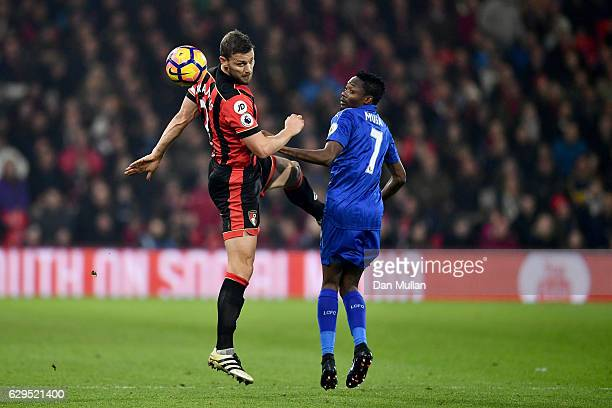Simon Francis of AFC Bournemouth heads the ball clear of Ahmed Musa of Leicester City during the Premier League match between AFC Bournemouth and...