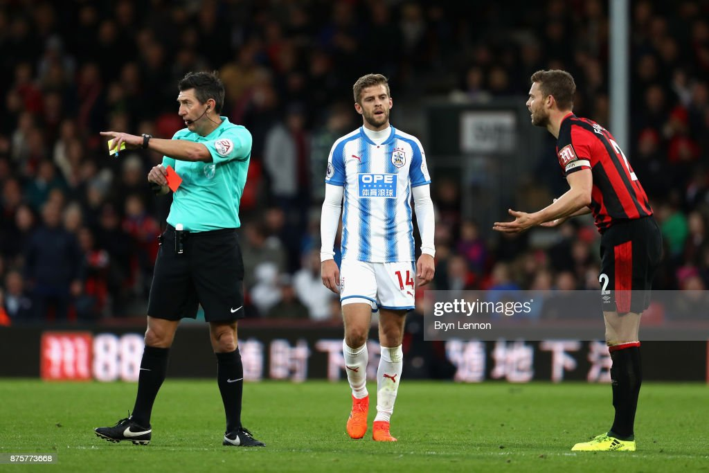Simon Francis of AFC Bournemouth is shown a red card by referee Lee Probert during the Premier League match between AFC Bournemouth and Huddersfield Town at Vitality Stadium on November 18, 2017 in Bournemouth, England.