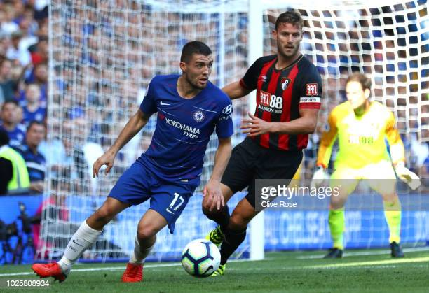 Simon Francis of AFC Bournemouth puts pressure on Mateo Kovacic of Chelsea during the Premier League match between Chelsea FC and AFC Bournemouth at...